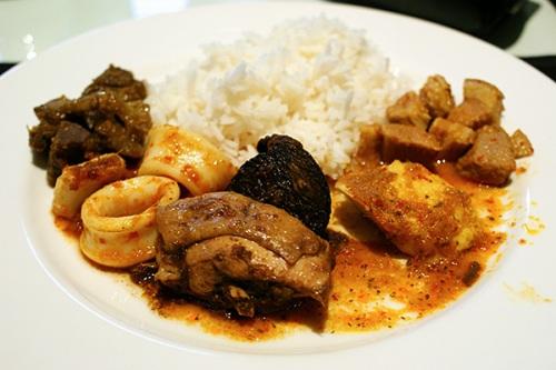 From left: Beef rendang, sambal sotong, ayam buah keluak, sambal tenggiri, babi assam.